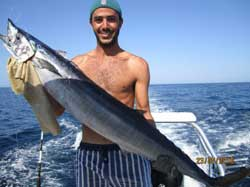Loreto man catches big fish.
